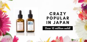 Japanes beauty serum skincare products on white background surrounded with different flowers on the side