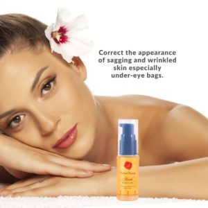 Beautiful Woman with white flower on ear promoting Japanese beauty oil skincare product
