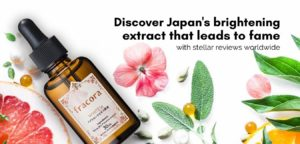 Japanese skincare product flay lay on white background surrounded with citrus fruits, flowers and leaves.